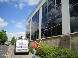 Clean and bright windows cleaning a high windows on a commercial Bath property
